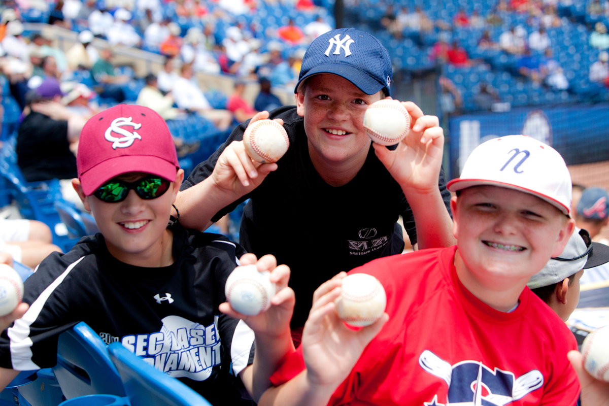 three kids with baseballs
