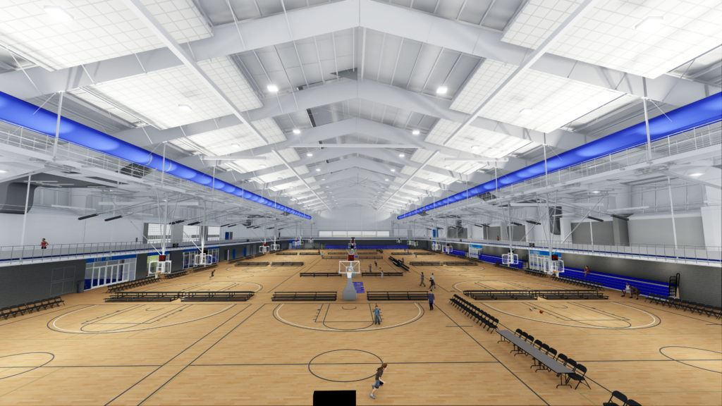 Image from upper level of large gymnasium complex with twelve small courts